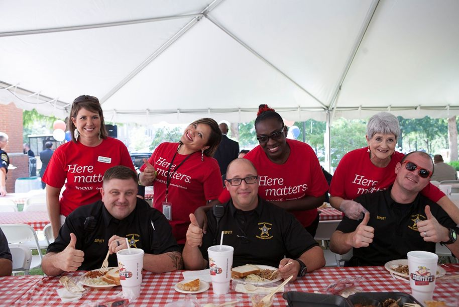 EMS personnel being served at a picnic