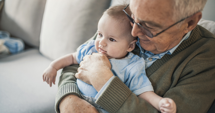 Grandfather holds baby how much life insurance do I need