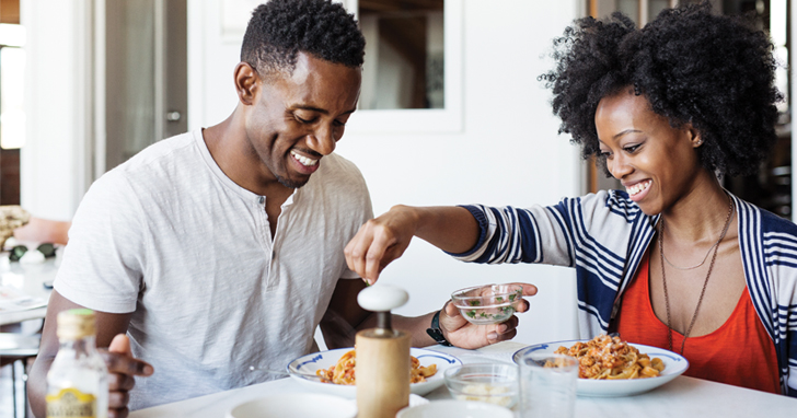 Couple enjoys breakfast of cereal together